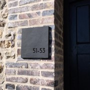 Slate plaque with cutout numbers